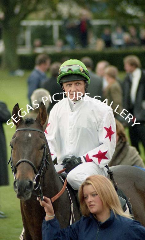 The Jockey Kevin Darley @ Newmarket on the 16th October 2004 in the colours of Mr Mitaab Abdullah